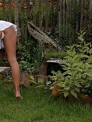Amber flowers herself in her garden, and we've been invited to come watch! Knowing that we are watching, she quickly strips her clothes off and g
